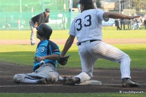 b208202a5ac Dimitri Leon steals third base in the 7th inning... ...Third baseman Sjoerd  Hermans makes the tag... (Photo  Fred Reuling)